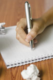 Hand writing with pen on notebook Stock Photo
