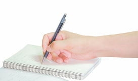 Hand writing with pen on paper Royalty Free Stock Photography