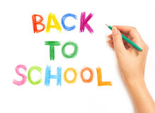 Hand writing with a pencil - Back to school Stock Photography