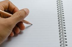 Hand Writing with Pencil. Royalty Free Stock Photo