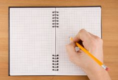 Hand writing by pencil on notebook. Hand writing by pencil on checked notebook Royalty Free Stock Photo