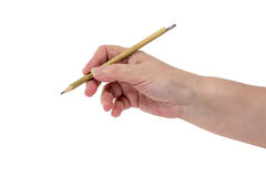 Hand is writing with a pencil. Senior woman`s hand with a pencil isolated on white background Stock Image