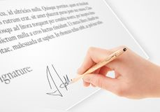 Hand writing personal signature on a paper form Royalty Free Stock Image
