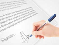 Hand writing personal signature on a paper form Royalty Free Stock Photo