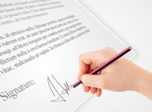 Hand writing personal signature on a paper form Royalty Free Stock Images