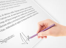Hand writing personal signature on a paper form Stock Image