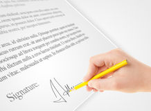 Hand writing personal signature on a paper form Stock Photos