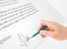 Hand writing personal signature on a paper form Royalty Free Stock Photography