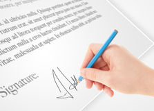 Hand writing personal signature on a paper form Royalty Free Stock Photos