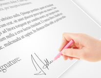 Hand writing personal signature on a paper form Stock Images