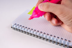Hand writing by pink on empty notepad, white background Stock Image