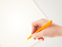 Hand writing on plain empty white paper copy space Royalty Free Stock Photography