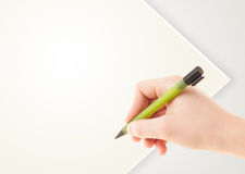 Hand writing on plain empty white paper copy space Stock Photo