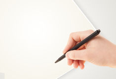 Hand writing on plain empty white paper copy space Royalty Free Stock Photos