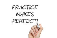 Hand writing practice makes perfect. Practice makes perfect handwritten with a marker on a whiteboard Royalty Free Stock Photography