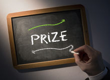 Hand writing Prize on chalkboard Stock Photos