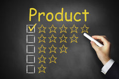 Hand writing product golden rating stars on chalkboard Royalty Free Stock Image
