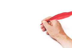 Hand writing red feather on white background Royalty Free Stock Photos
