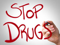 Hand writing with red marker on transparent wipe board - Stop Drugs Stock Images
