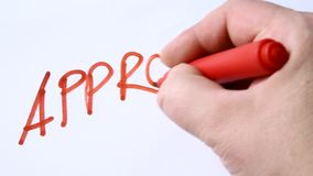 Hand writing with red pen word approved stock video