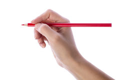 Hand writing with red pencil Stock Image
