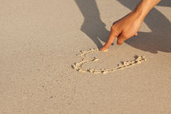 Hand writing in sand in summer holidays on beach Stock Image