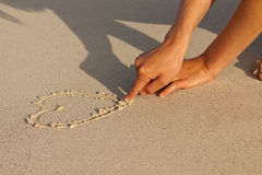 Hand writing in sand in summer holidays on beach Stock Photography