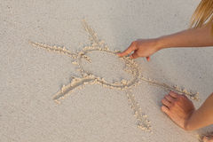 Hand writing in sand in summer holidays on beach Royalty Free Stock Photography