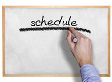 Hand writing schedule on board Royalty Free Stock Photography