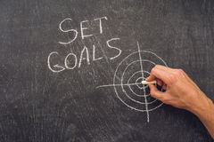 Hand writing Set Goals topic on chalkboard stock photo
