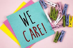 Hand writing showing We Care Motivational Call. Business photo showcasing Give People Help Attention Support Assistance. Conceptual hand writing showing We Care Royalty Free Stock Photography