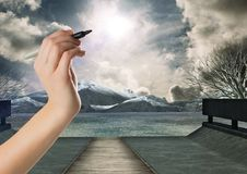 Hand writing in sky of mystical dramatic landscape Royalty Free Stock Photos