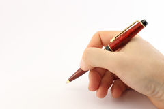 Hand writing with a sleek pen stock photo