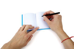 Hand writing on a small notebook Royalty Free Stock Images