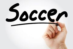 Hand writing Soccer with marker