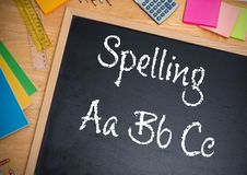 Hand writing Spelling text on blackboard. Digital composite of Hand writing Spelling text on blackboard Royalty Free Stock Photography