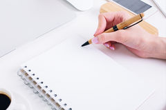 Hand writing in spiral notepad closeup Stock Images