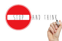Hand writing stop think sign. Stop and think handwritten with a marker on a whiteboard with a stop sign Stock Photos