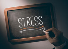Hand writing Stress on chalkboard Stock Images