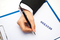 Hand writing with success Royalty Free Stock Photos