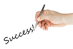 Hand writing success word. On white background Stock Photography