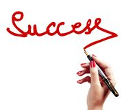 Hand writing the Success word Stock Photography