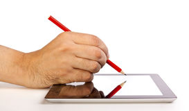 Hand writing on a tablet with a pencil Royalty Free Stock Images