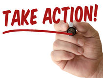 Hand writing take action. With red marker on transparent wipe board Royalty Free Stock Photography