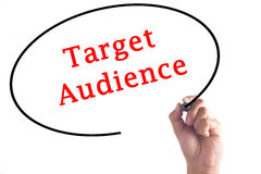Hand writing Target Audience on transparent board.  Royalty Free Stock Photo