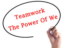 Hand writing Teamwork The Power Of We on transparent board.  Stock Images
