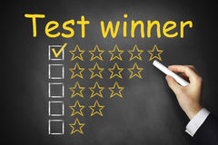 Hand writing test winner on chalkboard Royalty Free Stock Images