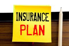 Hand writing text caption inspiration   Insurance Plan. Business concept for Health Life Insured written on sticky note paper on t. Hand writing text caption Stock Photo