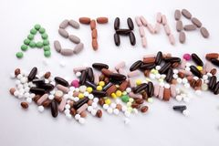 Hand writing text caption inspiration Medical care Health concept written with pills drugs capsule word asthma On white  b Royalty Free Stock Images