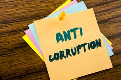 Hand writing text caption inspiration showing Anti Corruption. Business concept for Bribery Corrupt Text written on sticky note pa. Per on wooden background Stock Photography